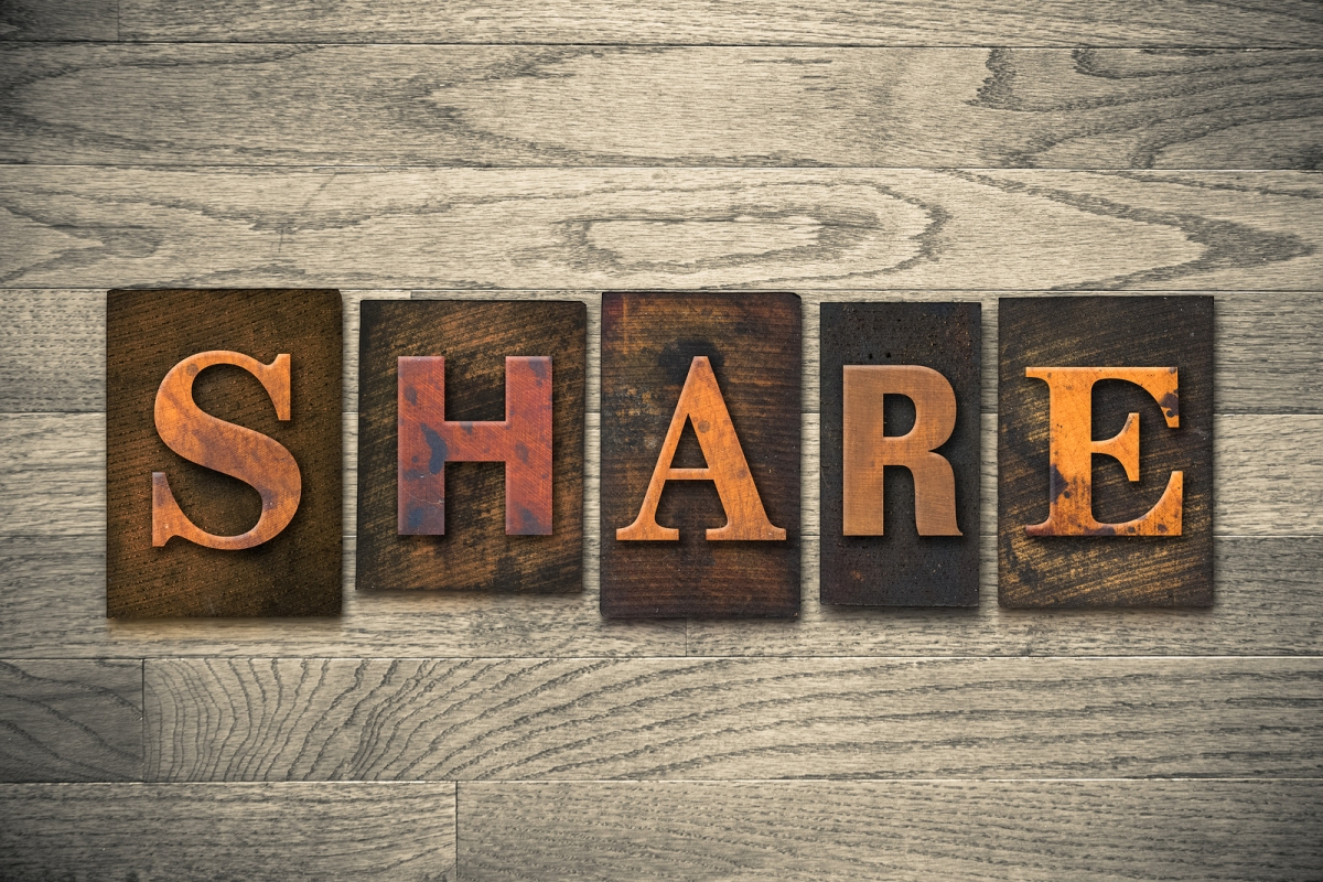 """The word """"SHARE"""" written in wooden letterpress type."""